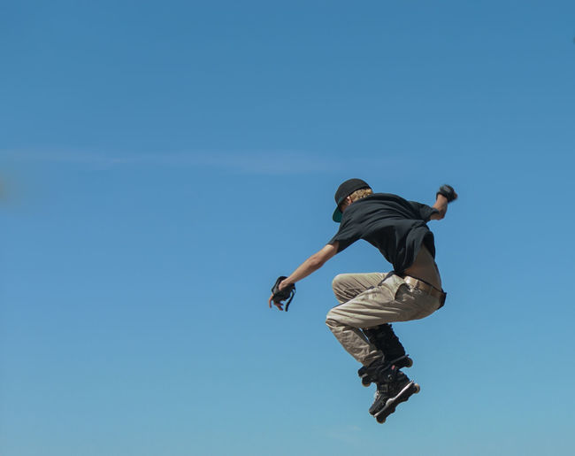 Adventure Blue Casual Clothing Day Enjoyment Freedom Full Length Fun Jumping Leisure Activity Lifestyles Low Angle View Mid-air Motion Nature Outdoors Skill  Sky