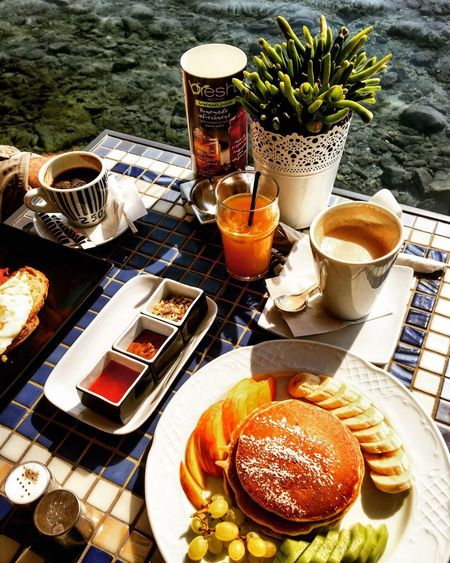Breakfast by the sea Food And Drink Coffeelover Happiness Holidays Morning Light Pancakes Beautiful Scenery Gourmet Food Glamour Photography Seaside Al Fresco Drink Food And Drink Coffee - Drink Coffee Cup Plate Refreshment Table Drinking Glass Food Freshness Indulgence High Angle View Healthy Eating Sweet Food No People Breakfast Croissant Day Food Stories