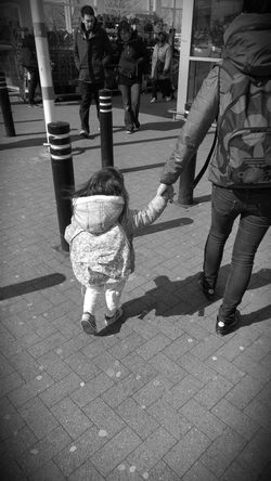 We have a backpacks Backpack Mother & Daughter Walking Around
