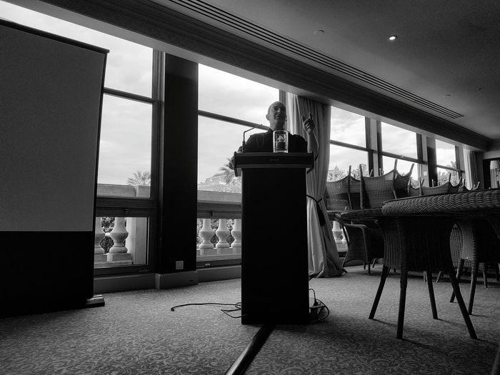 Confident businessman giving speech during event