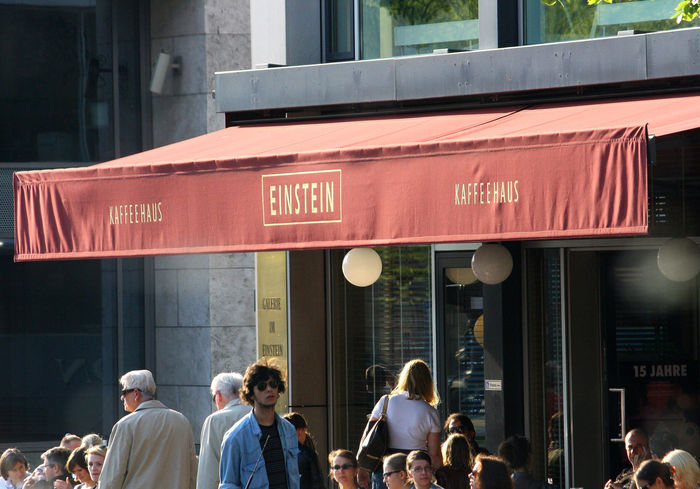 A Taste Of Berlin Berlin Coffee Shop Einstein Kafeehaus Einstein Coffeehouse Red Rain Cover Architecture Berlin Restaurants Building Exterior Built Structure City Communication Day Large Group Of People Men Outdoors People Real People Standing Text Women #urbanana: The Urban Playground