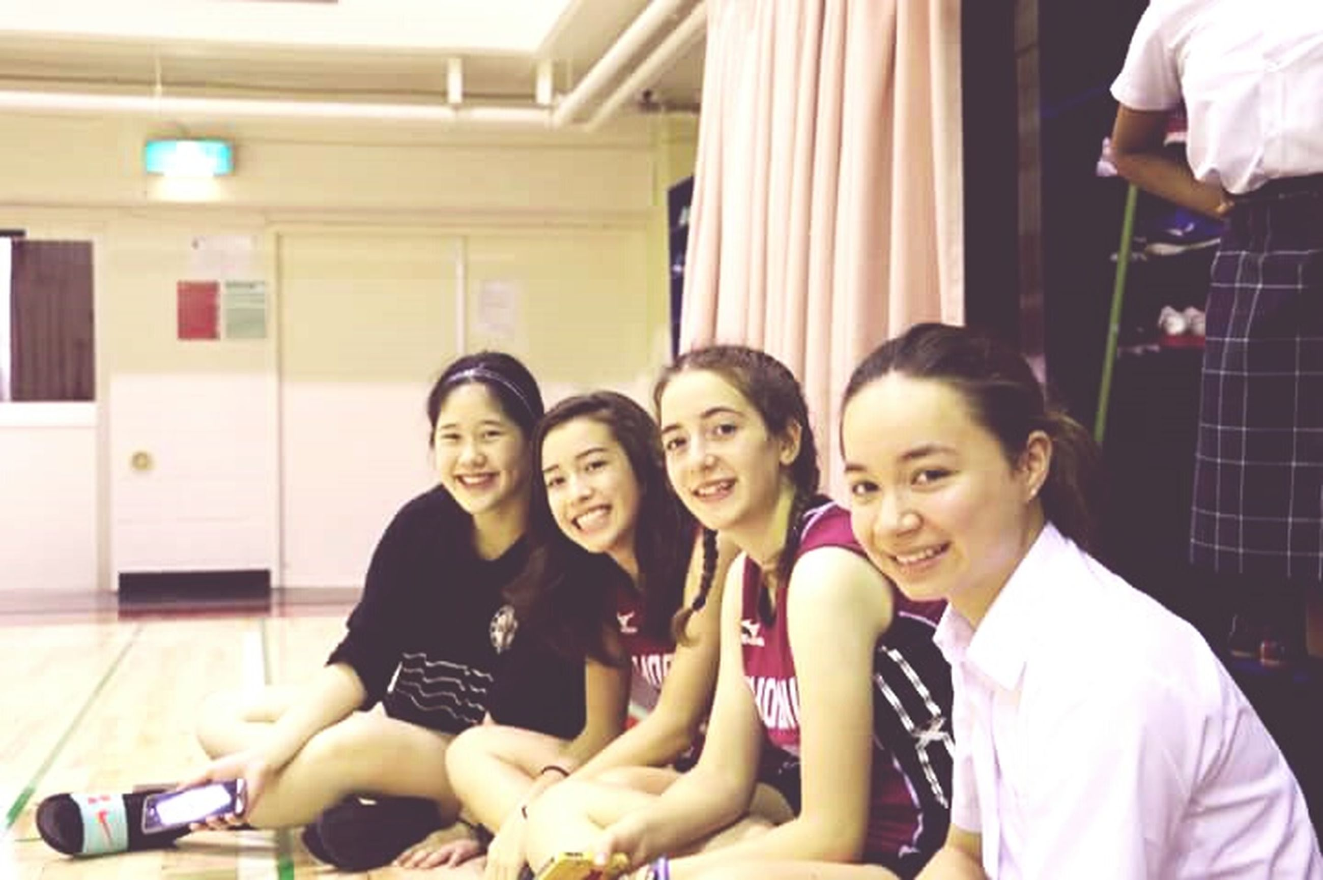 togetherness, leisure activity, lifestyles, bonding, friendship, standing, young women, young adult, teenage girls, indoors, happiness, casual clothing, person, friend, teenage boys, friends, looking