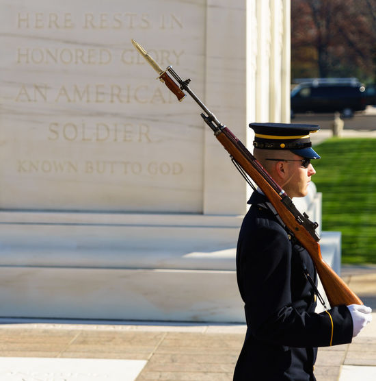 Arlington  Arlington National Cemetary Balance Communication Cropped Fallen Photographic Memory Holding Honor Guard Indoors  Leisure Activity Lifestyles Men Military Occupation Part Of Real People Showcase: December Soldier Standing Technology Text Tomb Of The Unknown Soldier Tradition Wall