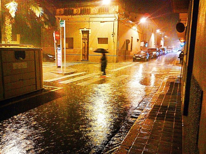 In the Rain. Water Walking City Illuminated Weather Night Street Outdoors Adults Only The Street Photographer - 2018 EyeEm Awards EyeEmNewHere