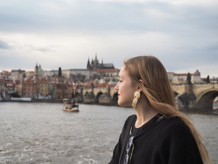 Portrait of woman with city in background