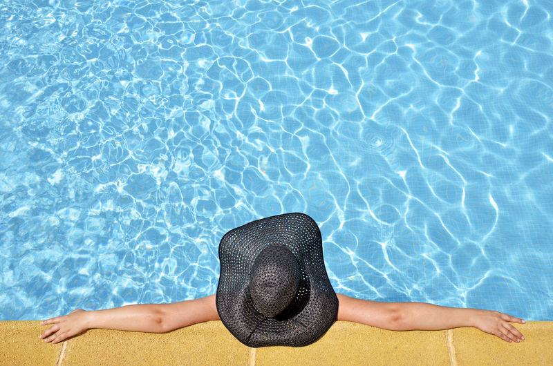 Day Leisure Activity Lifestyles One Person One Woman Only Outdoors People Real People Refraction Relaxation Summer Sun Hat Swimming Swimming Pool Vacations Water Women Young Women The Week On EyeEm