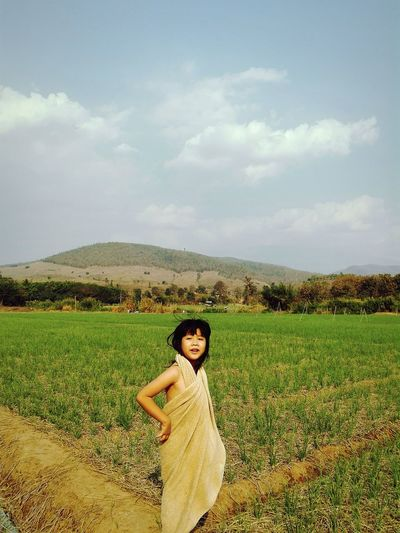 Girl Covered With Fabric While Standing On Agricultural Field