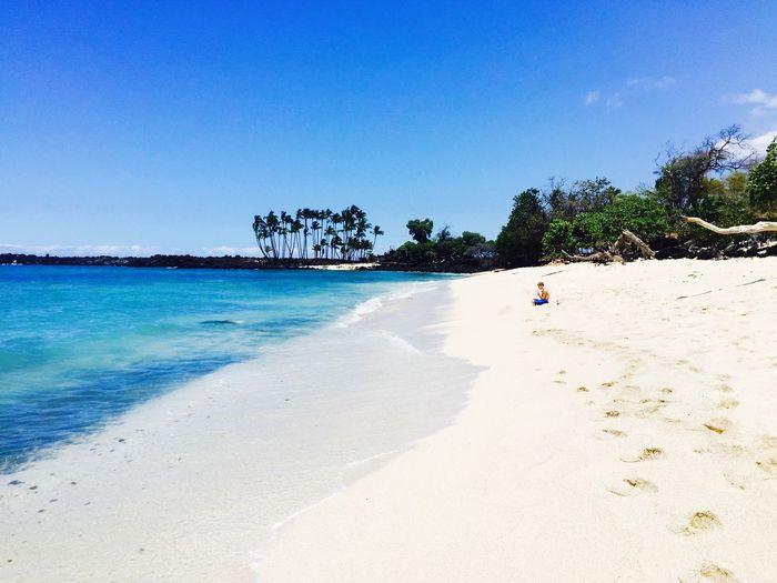 Boy On Hawaii Islands Against Clear Blue Sky