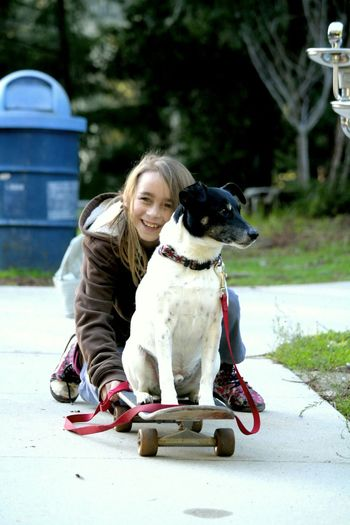 Lifestyles Leisure Activity Person Togetherness Day Outdoors Portraits PortraitPhotography Girls Elementary Age Sentimental Love Smiling Human Face Pets Pet Pet Photography  Dog Dogslife Skate Skateboarding Skateboard Skate Girl Skatedog