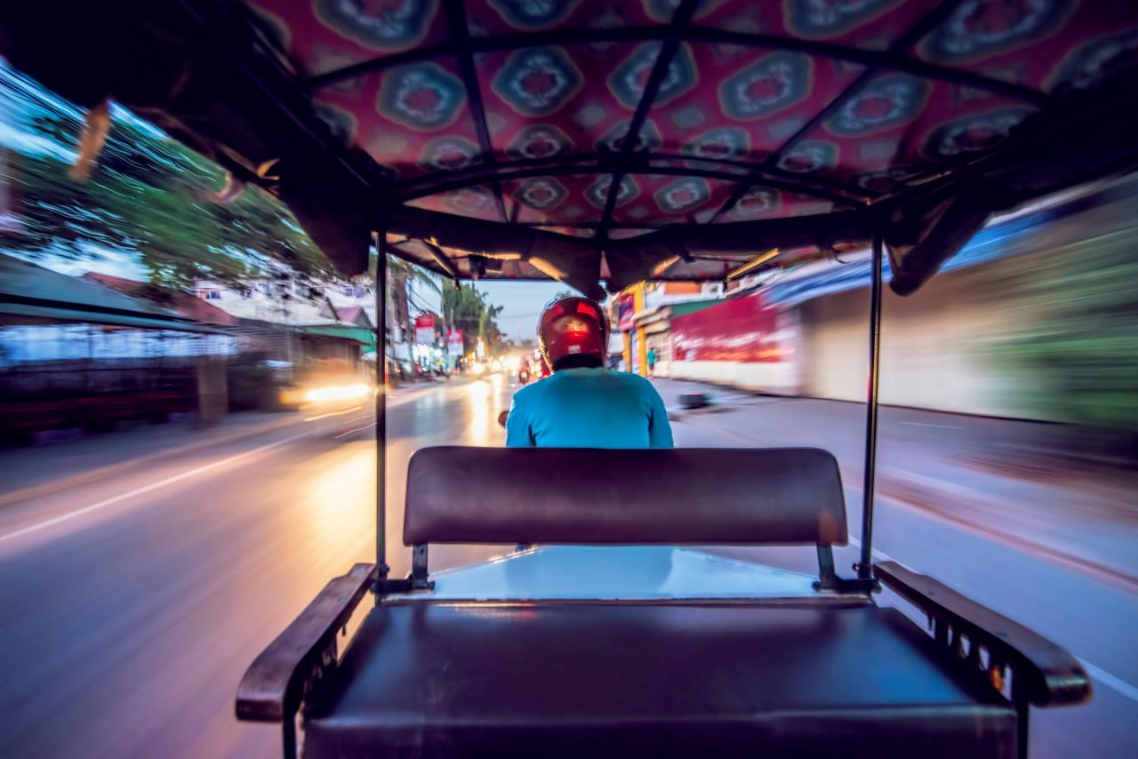 View from riding electric cart in city