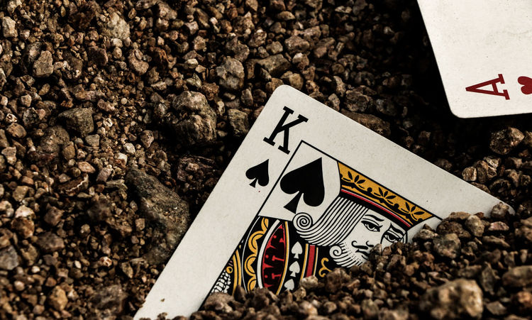 Ace Arrow Symbol Canonphotography Capital Letter Card Communication Creativity Direction Game Guidance Information Information Sign King Nature Non-western Script Number Road Sign Rough Sand Sign Symbol Text Wall Warning Sign Western Script