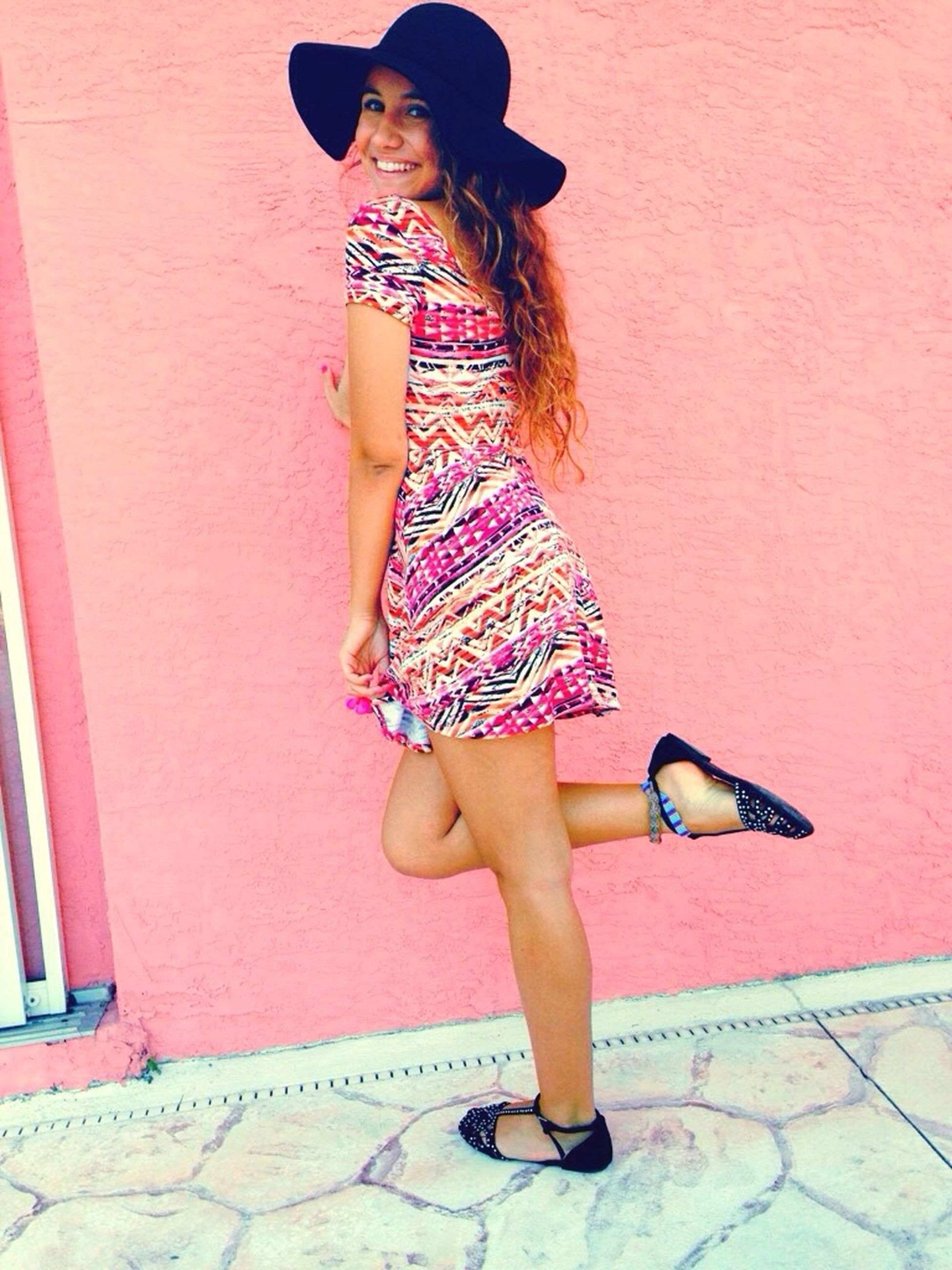 full length, lifestyles, young adult, casual clothing, young women, leisure activity, person, wall - building feature, standing, front view, dress, built structure, fashion, barefoot, architecture, sensuality, long hair