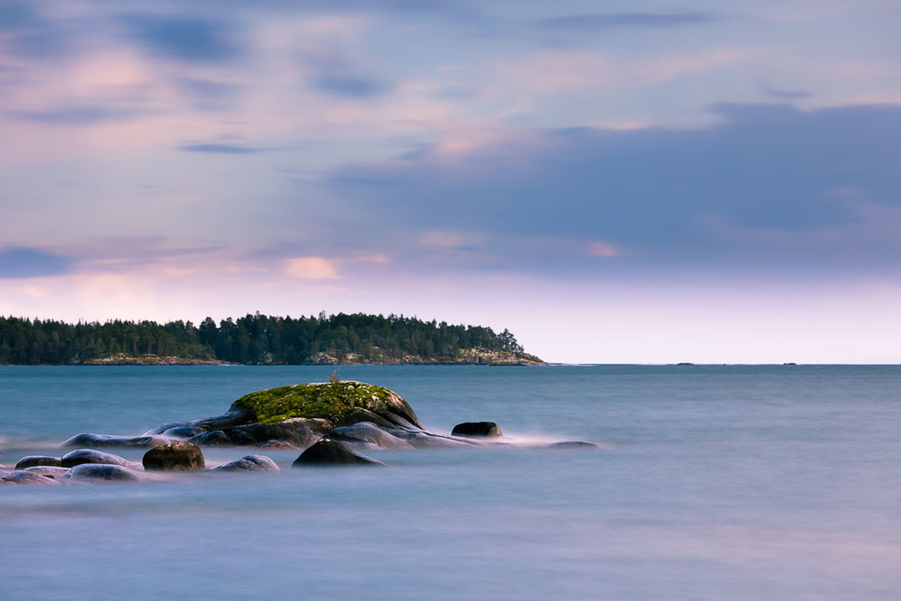 sea, sky, beauty in nature, nature, scenics, tranquil scene, tranquility, water, sunset, rock - object, cloud - sky, no people, idyllic, horizon over water, outdoors, beach, tree, day