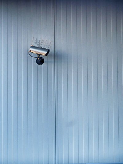 Security camera on patterned wall