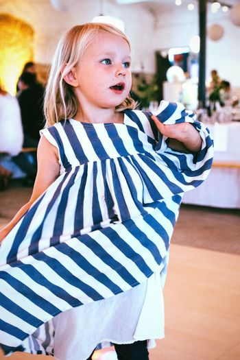 Dancing queen Powerful Party Time Enjoying Life Lifestyles Young Girl Girl Blonde Girl Party Time Wedding Party Dancing Queen Passionate Dancer Childhood Child Stage Wedding Dancing Girl Dancing Striped Happiness Blond Hair Cute Real People Smiling One Person Fun Childhood Girls Cheerful Portrait