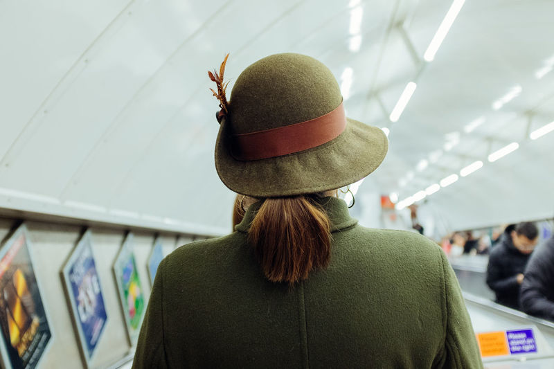 Rear view of man and woman wearing hat