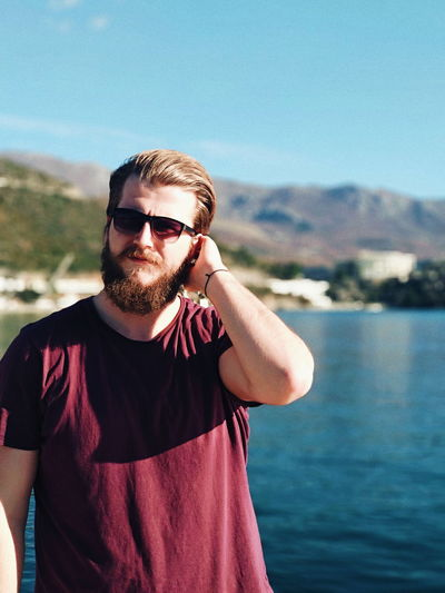 VSCO Seascape Seaside Sea And Sky Sea Life Focus IPhoneography IPhone Iphonephotography Nature Portrait Water Summer Looking At Camera Men Sunglasses Standing Sky Masculinity Posing Bicep Flexing Muscles Torso Human Muscle Mug Shot Shore Horizon Over Water Handsome Macho Blooming