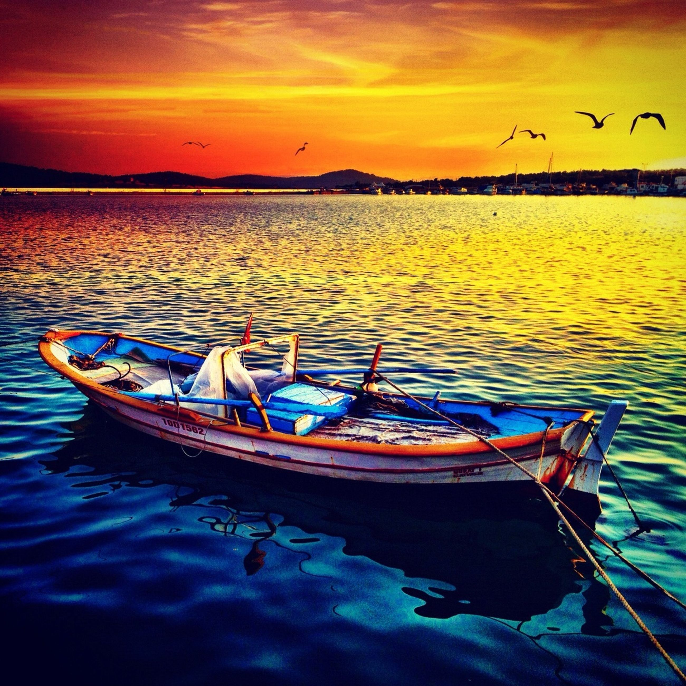 nautical vessel, boat, transportation, water, moored, mode of transport, sunset, reflection, tranquil scene, tranquility, sky, waterfront, scenics, lake, nature, travel, sea, beauty in nature, idyllic, dusk