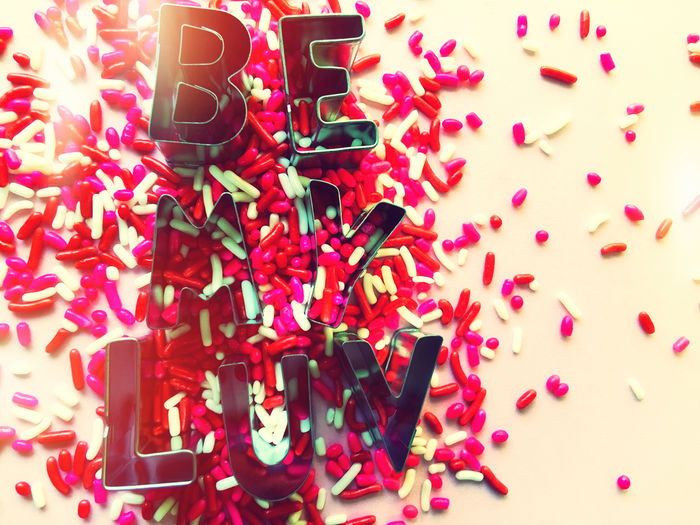 Be My Luv words with sprinkles Backgrounds Be My Luv Candy Close-up Communication Copy Space Filtered Indoors  Large Group Of Objects Letters Love Message Multi Colored Nobody Phone Camera Pink Red Sprinkles Studio Shot Sweets Text Valentine's Day  White Color Words