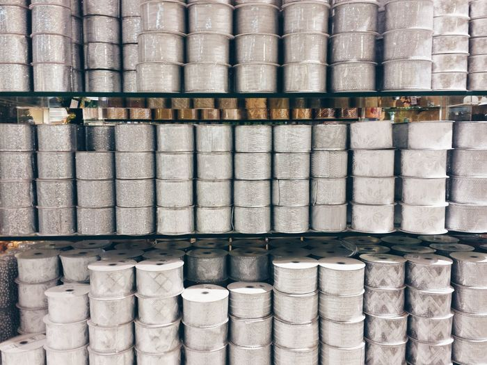 Full Frame Shot Of Rolls On Shelves At Factory