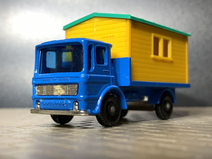 Close-up of toy car against blue sky