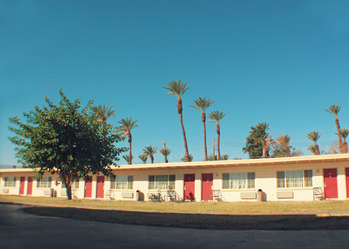 Low Angle View Architecture Blue Building Exterior Built Structure Cinder Block Motel Clear Sky Day No People Outdoors Palm Tree Sky Vintage Motel Vintage Motel Sign