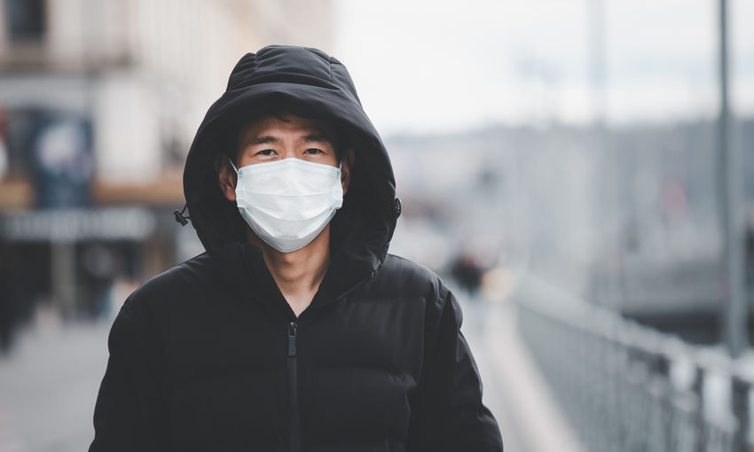 Portrait of man wearing face mask standing outdoors
