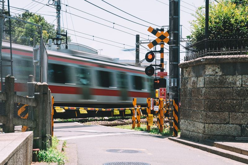 Blurred motion of train on street in city