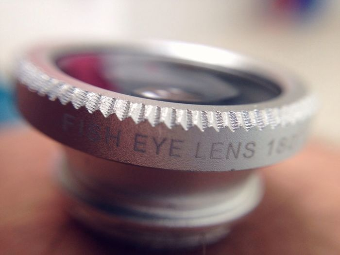 Close-up of text on lens