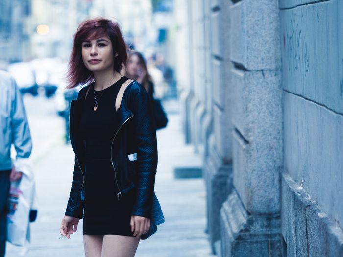 Woman smoking a cigarette on street