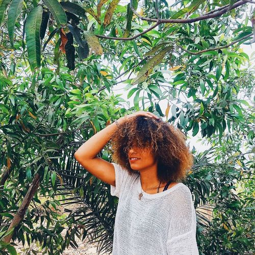 Curly Hair One Girl Only Green Color Nature Waist Up Outdoors Tree Close-up Congo Mixed Girl
