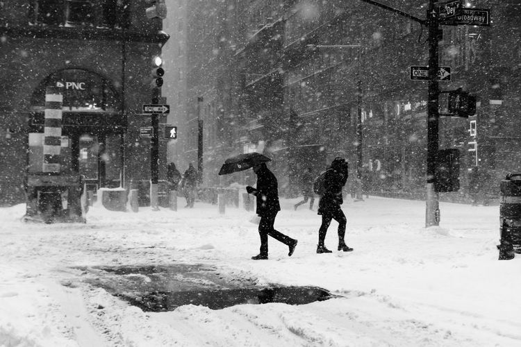 Men on road in city during winter