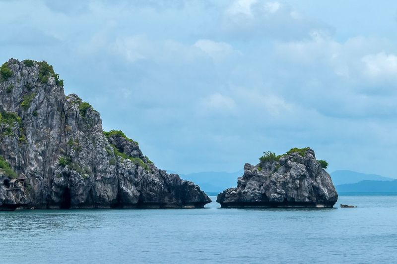 Water Sea Scenics - Nature Sky Beauty In Nature Cloud - Sky Rock Tranquil Scene Rock Formation Tranquility No People Rock - Object Nature Solid Blue Idyllic Outdoors Land Island Beach