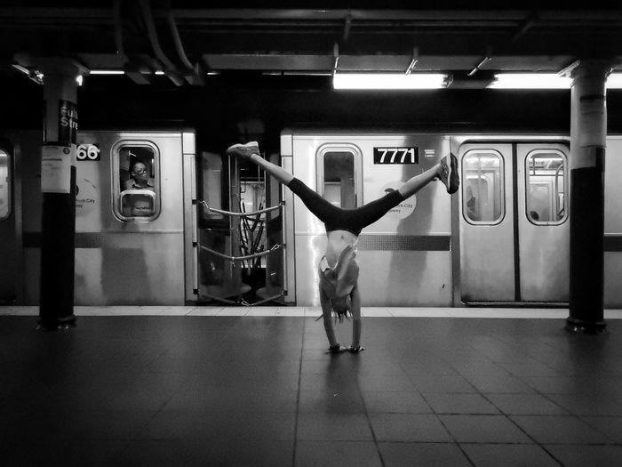 Rear view of man standing at subway station
