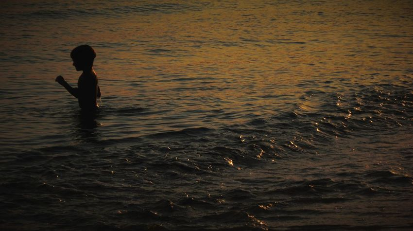Landscape_Collection Ankle Deep In Water Beach Beachphotography Beauty In Nature Childhood Day Lifestyles Nature One Person Outdoors People Real People Rippled Sea Sea And Sky Sunset Water