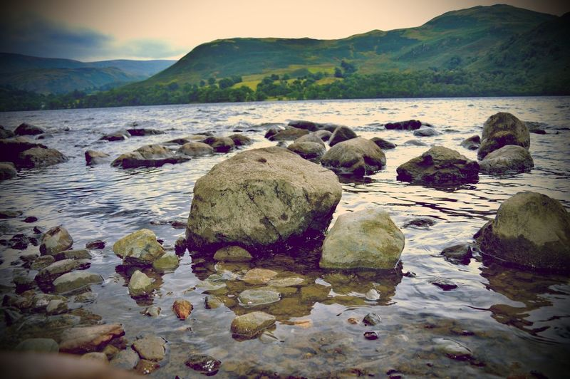 Rocks in the lake Rock - Object Landscape Outdoors No People Nature Scenics Mountain Beach Day Water Sky EyeEm Selects Taking Photos The Week On EyeEm Focus On Foreground Beauty In Nature Lake District Lake View Tranquility Nature Clouds And Sky