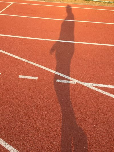 Shadow Of Man On Running Track