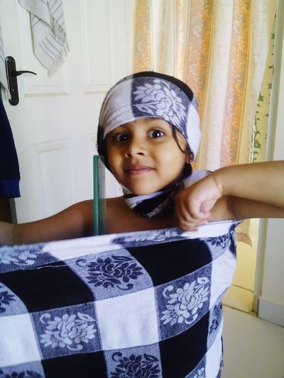 Portrait of little girl wearing sari at home