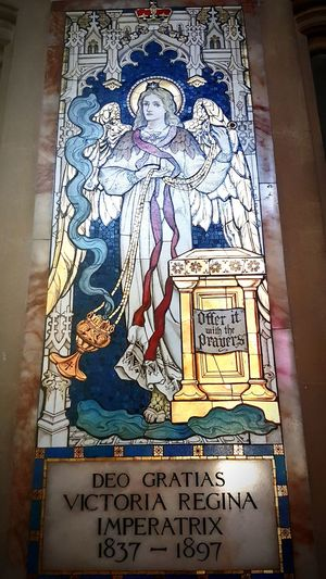 Text History Archival Indoors  Symbolic  St Martin's Church Place Of Worship Stained Glass Female Likeness Royal Crest Coat Of Arms Multi Colored Window