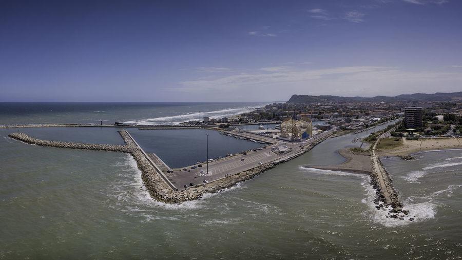 Aerial view of sea against sky in city
