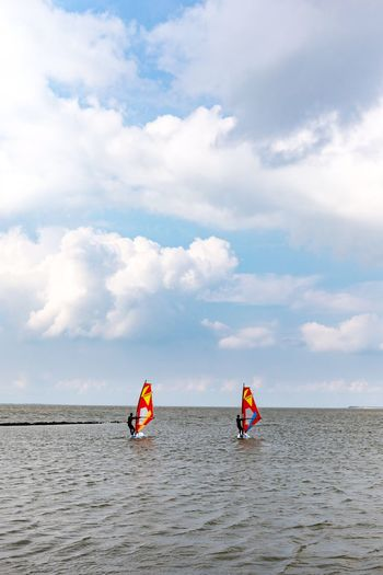 Neuharlingersiel, North Germany Real People Sea Adventure Cloud - Sky Leisure Activity Sky Day Water Nature Men Lifestyles Extreme Sports Vacations Scenics Weekend Activities Beauty In Nature Outdoors Skill  Horizon Over Water Sport Windsurfing