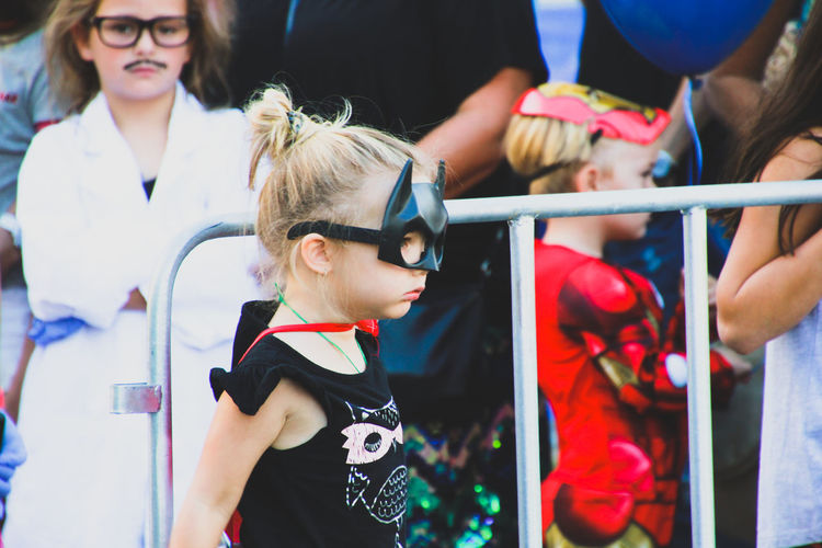 Boys Catwoman Child Childhood Children Close-up Costume Family Fancy Dress Girls Leisure Activity Lifestyles Outdoors Real People Standing Street Street Photography Superhero Superheroes
