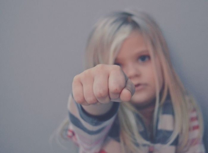 Portrait of girl showing fist