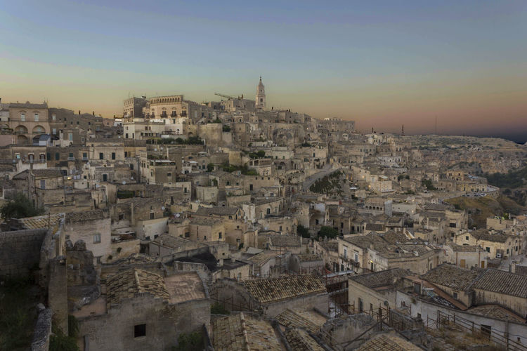 Matera Italy Unesco UNESCO World Heritage Site Cityscape Urban Overview Architecture Sky Building Exterior Built Structure City Crowd Building Crowded Residential District Nature Sunset Community Outdoors Travel Destinations High Angle View Town Clear Sky TOWNSCAPE Settlement