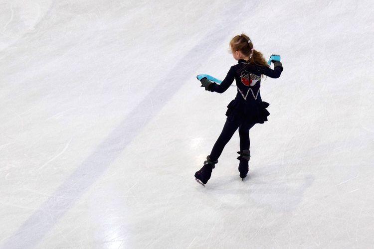 Rear view full length of girl ice-skating