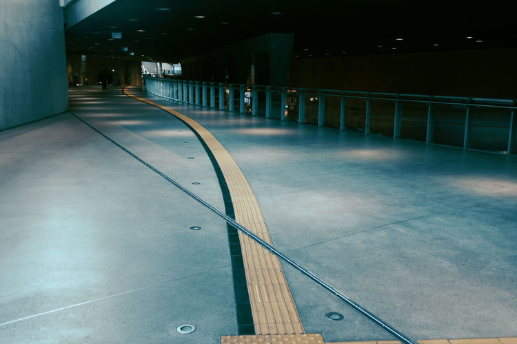 DOWN UNDER Absence Architectural Column Architecture Building Building Exterior Built Structure City Connection Diminishing Perspective Direction Empty Flooring Illuminated In A Row Night No People Outdoors Railing The Way Forward Transportation Twodayscologne