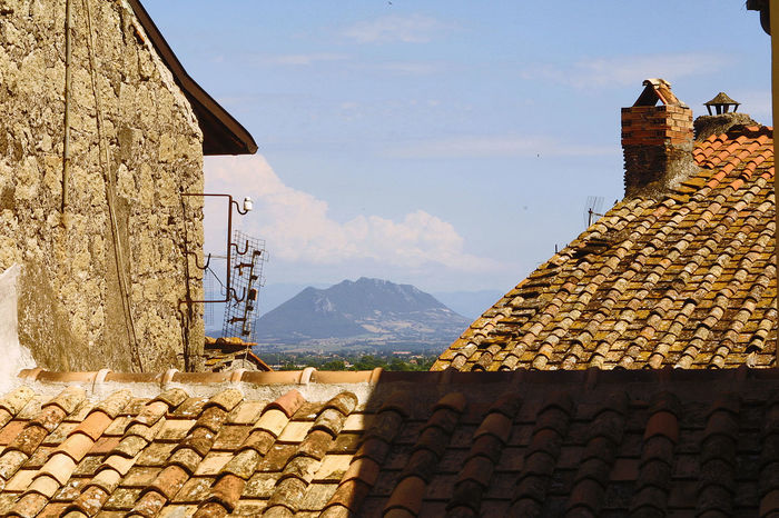 Roofs with mountain view Chimney Italia Television Antennas Architecture Building Exterior Built Structure Clouds Clouds And Sky Etruria Landscape Lazio Mountain Mountain Range Outdoors Roof Shingles Sky Tiled Roof  Via Amerina