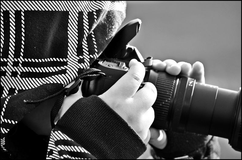 Close-Up Of Person Photographing With Digital Camera