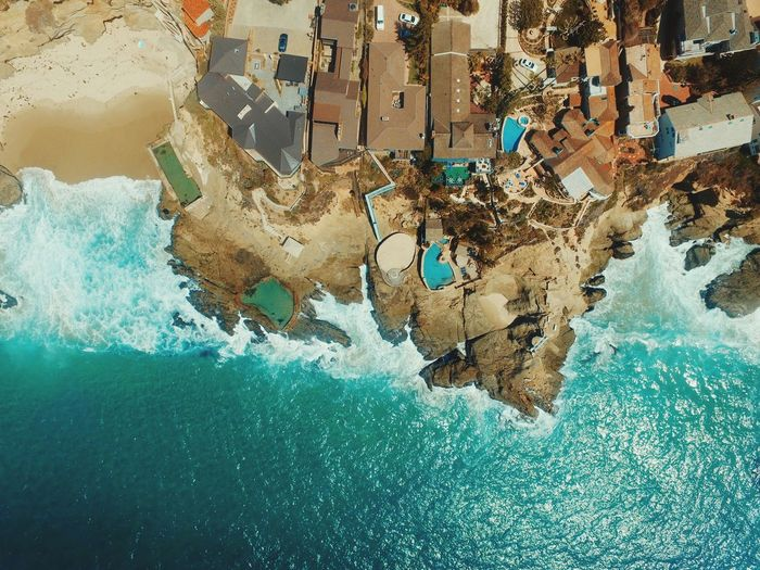 Directly above shot of coastlines by houses