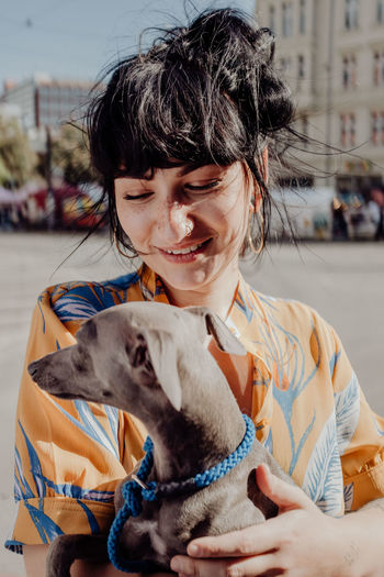 Domestic Domestic Animals Mammal Pets One Animal Real People One Person Canine Dog Lifestyles Vertebrate Leisure Activity Focus On Foreground Portrait Casual Clothing Child Pet Owner Mouth Open Smiling Smiling Girl Girl And Dog The Portraitist - 2019 EyeEm Awards